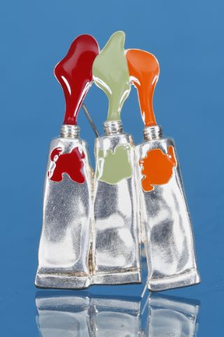 Broche tubes de couleurs orange, vert et rouge