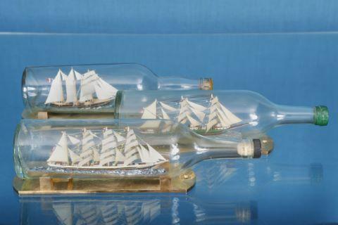 3 bateaux en bouteille