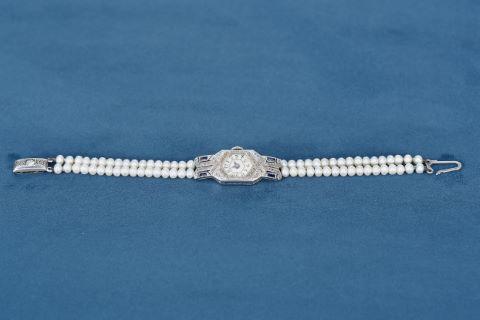 Montre de dame + 1 bracelet