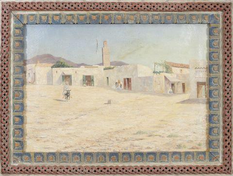 À dos d'âne, près de la médina, au loin un minaret
