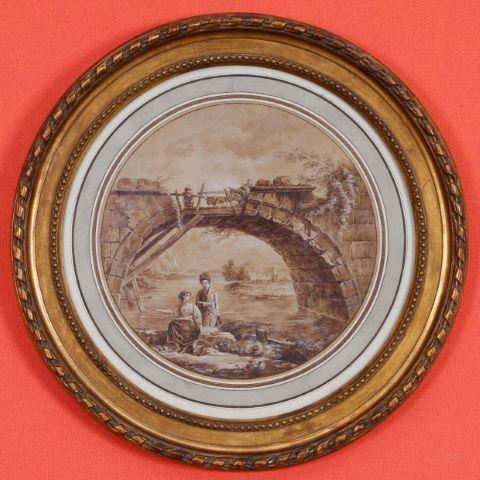 Femmes au bord de la rivière sous un pont