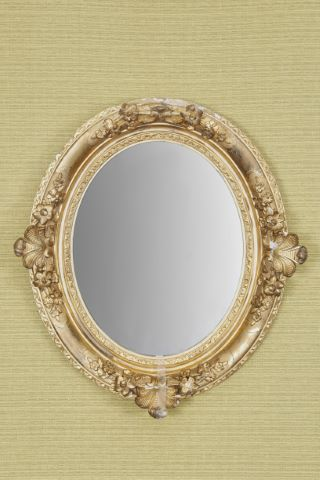 Miroir ovale d'époque Restauration
