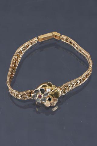 Montre de dame transformée en bracelet