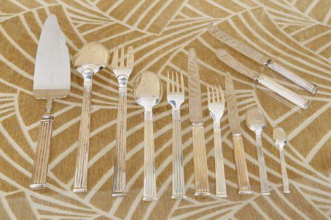 Importante partie de ménagère en métal argenté, modèle triade, style Art Déco