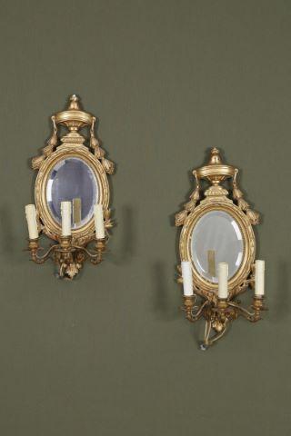 Paire d'appliques médaillon à fond miroir à 3 bras de lumière